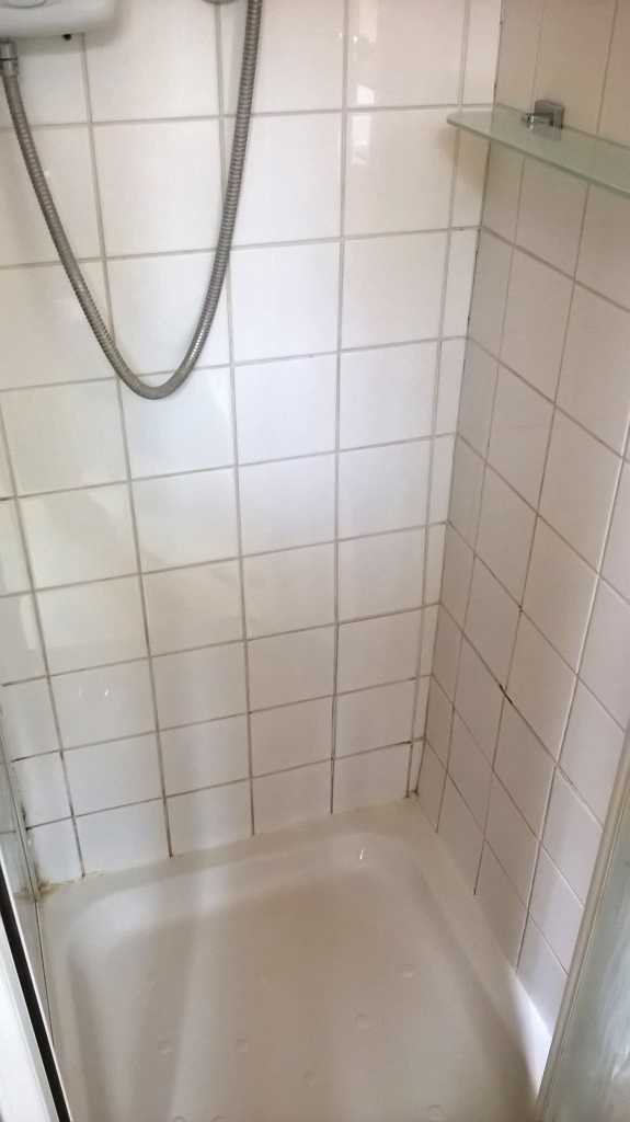 Grout Colouring Ceramic shower tiled cubicle in stafford before